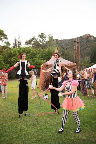 tents-and-stilt-walker-juggler-at-wedding-reception-malibu-cj-lana-perrys-circus-theme-wedding