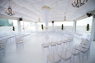 white-tent-and-pillar-surrounded-by-clear-chairs