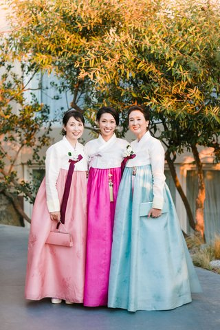 bride-with-female-family-members-mother-in-traditional-korean-wedding-attire-hanbok-in-pink-and-blue