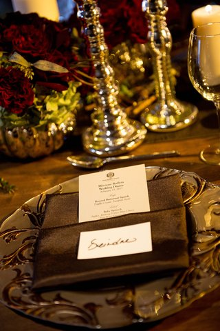 elegant-menu-tucked-into-brown-dinner-napkins