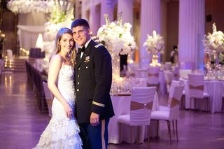 bride-and-groom-in-houston-wedding-with-dress-blues