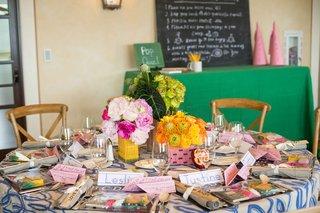 pink-peonies-in-pencil-centerpiece-yellow-flowers-in-pink-eraser-centerpiece-green-in-ruler-vase