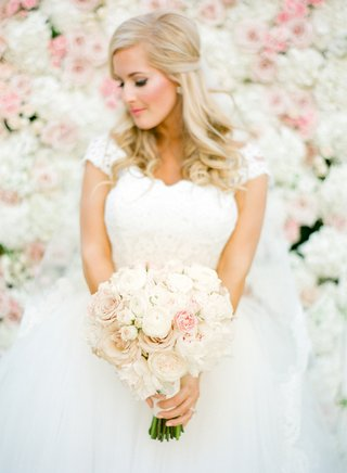 bride-in-a-monique-lhuillier-gown-with-lace-bodice-and-tulle-skirt-with-pink-and-white-bouquet