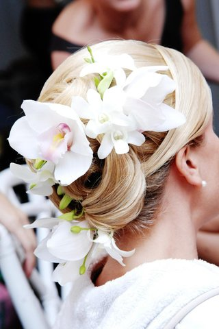 blonde-updo-with-white-orchid-hair-accessory