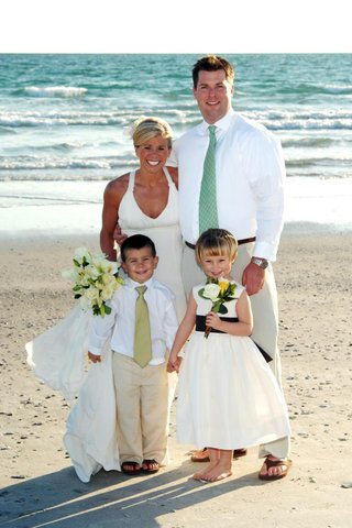 bride-and-groom-with-flower-girl-and-ring-bearer-on-beach