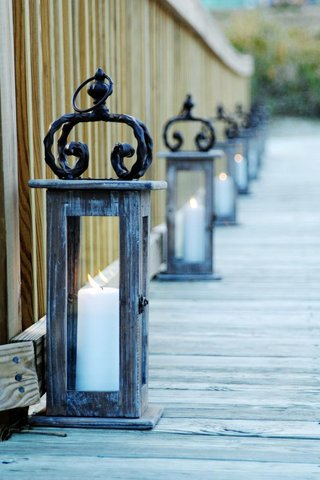 distressed-wood-and-iron-lantern-with-pillar-candle