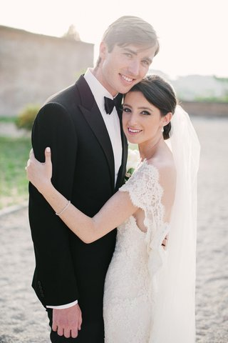 bride-in-lace-dress-with-groom-in-italy
