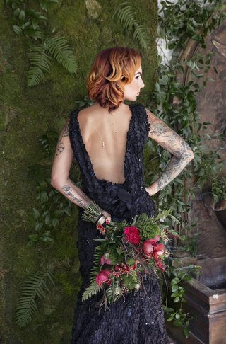 bride-in-a-black-r-mine-bespoke-dress-with-appliques-cowl-back-bouquet-with-greenery-red-flowers