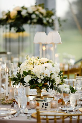 wedding-reception-table-round-table-taper-candles-gold-vase-with-white-flowers-greenery-centerpiece
