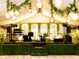wedding reception live band stage with boxwood hedge to bring outside in eastcoast entertainment