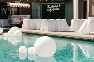 brandin-cooks-backyard-wedding-pool-with-trendy-matte-white-balloons-floating