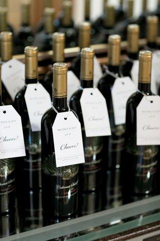 wedding favors for guests wine bottles with cheers tags from couple malibu rocky oaks vineyard