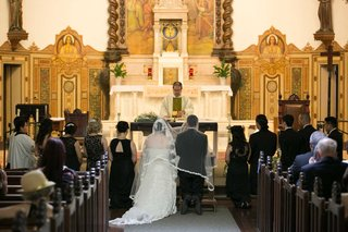 catholic-ceremony-california-church-long-veil-white-dress-black-tuxedo-religious-vows-wedding