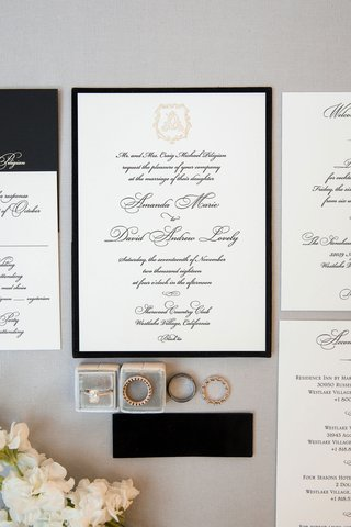 wedding invitation suite black border gold monogram calligraphy script with wedding rings