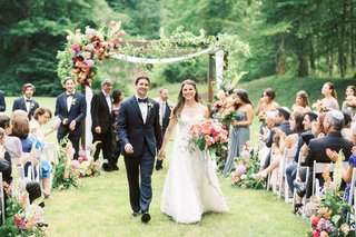 A Charming Fete Garden Ceremony bride and groom recessional