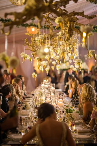wedding-reception-with-gold-grapewood-branches-and-individual-white-flowers-hanging-down