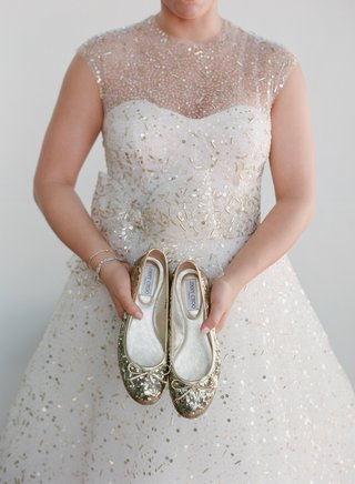 bride-holding-gold-sequin-jimmy-choo-flats