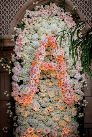 white-hydrangea-flower-wall-with-pink-and-orange-roses-forming-initial-letter-a