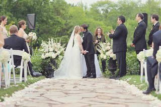 bride-and-groom-kissing-at-outdoor-ceremony