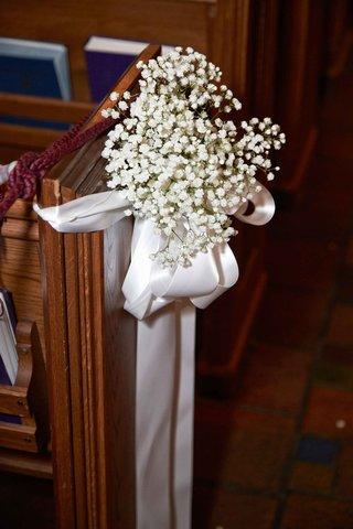 babys-breath-with-white-satin-ribbon-on-wood-church-pew-wedding-ceremony