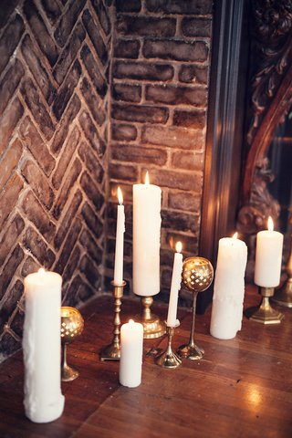 wedding-ceremony-in-the-grand-ballroom-of-the-ebell-long-beach-with-candles-in-the-fireplace