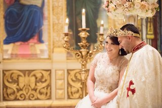 bride-and-groom-at-coptic-orthodox-wedding-ceremony-with-gold-crowns