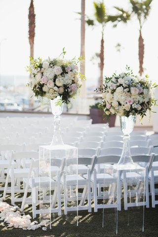 wedding-ceremony-ocean-view-white-chairs-flower-petal-aisle-clear-lucite-riser-pink-white-flowers