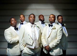 tracy-morgan-and-his-groomsmen-at-wedding-in-white-ivory-tuxedos-and-black-bow-ties