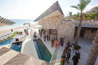 destination-wedding-ocean-views-ceremony-and-aisle-built-over-pool