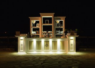 wedding-bar-stocked-with-bottles-of-alcohol