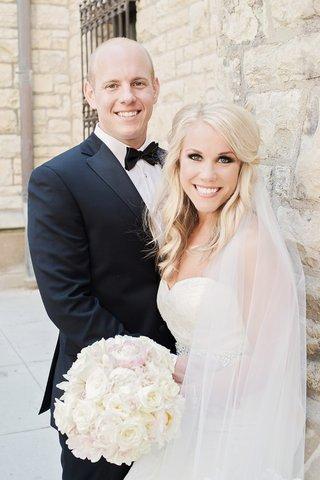 blond-bride-hair-half-up-loose-waves-vera-wang-cathedral-veil-groom-in-vera-wang-tux