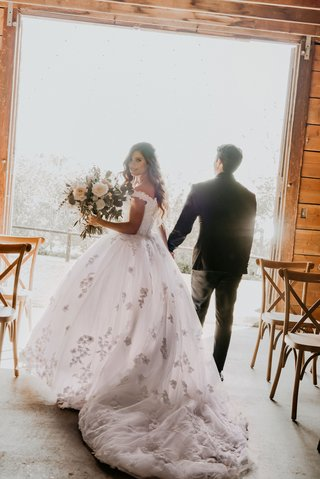 echosmith-singer-sydney-sierota-and-cameron-quiseng-wedding-portrait-walking-out-of-ceremony-room