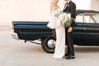 bride-in-white-off-shoulder-wedding-dress-groom-in-tuxedo-black-old-classic-car-mustang-on-roof
