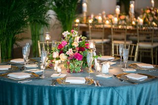 wedding-reception-in-key-west-with-bright-blue-linens-and-colorful-fall-hued-flower-arrangements