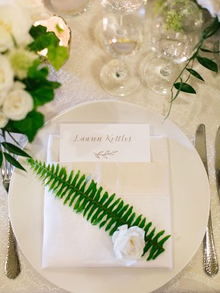 wedding-reception-place-setting-white-linen-napkin-with-green-fern-leaf-and-white-flower-custom-menu