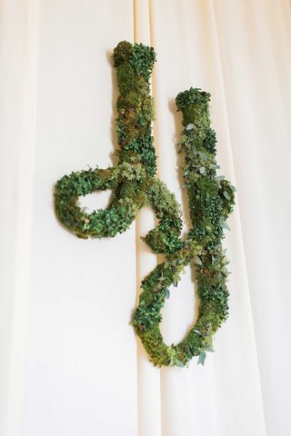 white-drapery-at-wedding-reception-with-verdant-greenery-installation-of-wedding-monogram-two-j