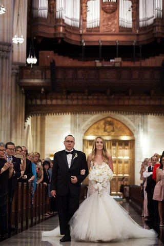 bride-in-galia-lahav-wedding-dress-trumpet-gown-orchid-bouquet-father-processional-church-pews