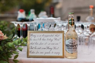 henrys-hard-soda-wedding-reception-cocktail-hour-with-calligraphy-sign-honoring-dog-puppy