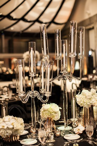 glass-candelabra-with-tapered-candles-as-part-of-wedding-reception-decor