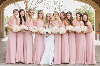 bride-in-romona-keveza-wedding-dress-with-brocade-applique-bridesmaids-in-blush-jenny-yoo-dresses
