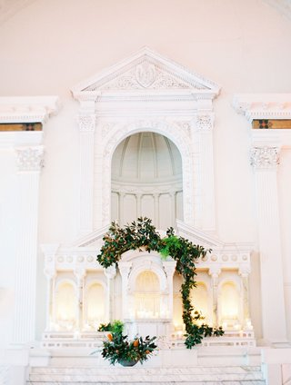 wedding-venue-vibiana-white-marble-altar-decorated-with-greenery-vines-pillar-candles