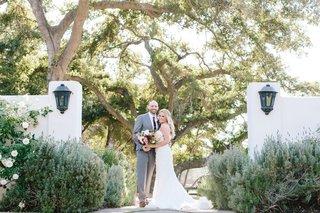 ojai-valley-inn-wedding-bride-in-oscar-de-la-renta-wedding-dress-groom-in-grey-suit