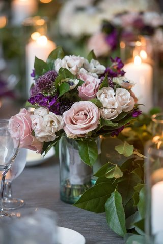 small-wedding-reception-centerpiece-pink-rose-anemone-buds-and-purple-flowers