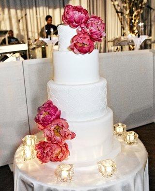 white-wedding-cake-with-fresh-pink-peony-flowers