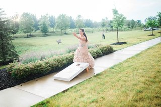 bride-in-blush-vera-wang-gown-plays-cornhole