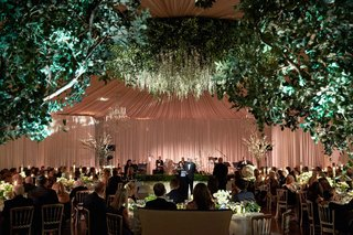 wedding-reception-flower-chandelier-tented-ballroom-drapery-head-table-dance-floor-live-band-low