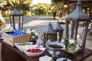 ranch-wedding-reception-with-sundae-table-with-wood-and-metal-lanterns-la-dogers-cap-bowls