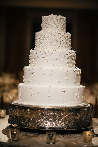 five-layer-traditional-white-wedding-cake-with-sugar-flowers-design-on-white-cake-monogram-on-tier