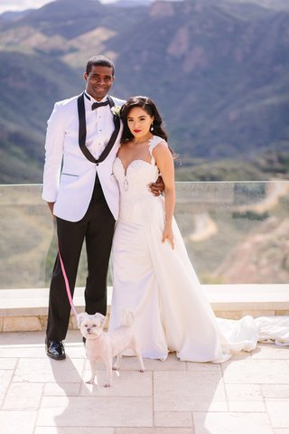 bride-in-riki-dalal-couture-detachable-train-on-sheath-gown-groom-in-white-jacket-caravelli-dog