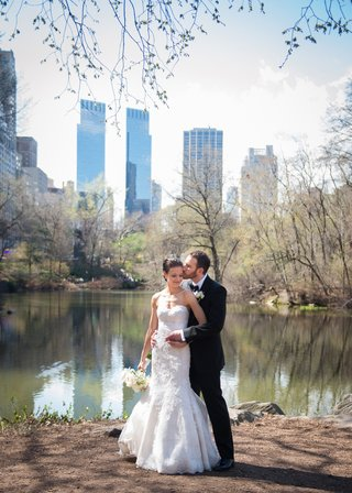 a-bride-and-groom-embracing-in-new-york-citys-central-park-during-their-first-look-before-ceremony